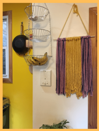 picture of kitchen wall with fruit basket and a crochet art